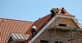 Roofers working on a tile roof